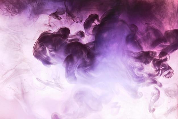 Colores vibrantes, fondo abstracto humo brillante. salpicadura de pintura en el agua, nube colorida en movimiento. concepto de narguile, fondo de perfumes y fondos de baile