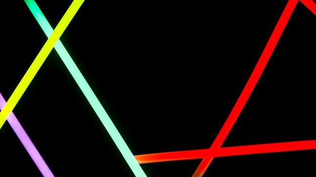 Coloridas luces de neón sobre fondo negro