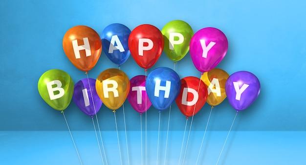 Coloridos globos de aire feliz cumpleaños en una escena de fondo azul. banner horizontal. render de ilustración 3d