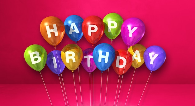 Coloridos globos de aire feliz cumpleaños en una escena de superficie rosa