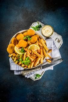 Comida británica, pescado y papas fritas