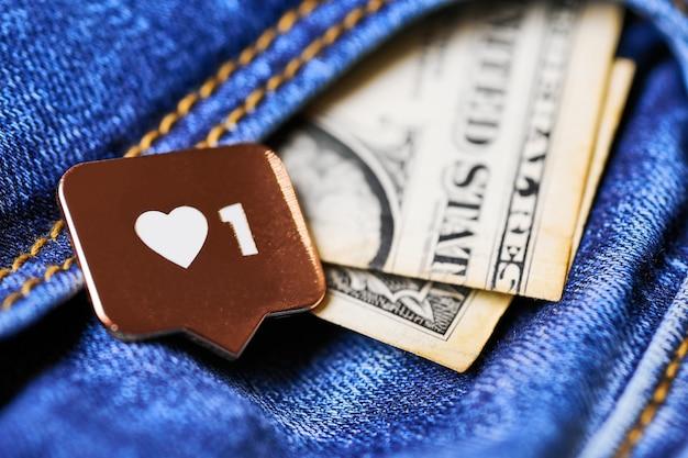 Como el símbolo del corazón y el dólar en el bolsillo de los jeans. como botón de signo, símbolo con corazón y un dígito. mercadeo en redes sociales.
