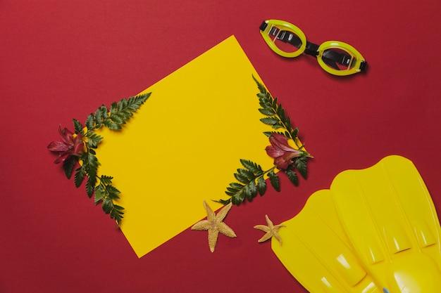 Composición colorida con gafas de nadar y aletas