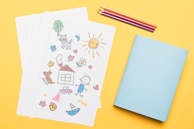 Composición de dibujo escolar y bloc de notas