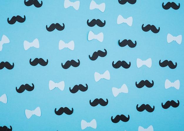 Composición de pajaritas y bigotes.