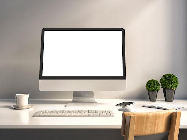 Computadora con pantalla blanca en la mesa de oficina