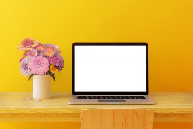 Computadora de pantalla en blanco colocada en una mesa de madera con árboles y auriculares en una habitación amarilla