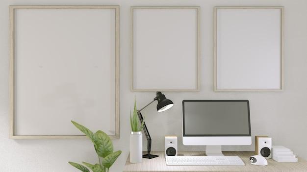Computadora con pantalla en blanco y decoración en sala de oficina. renderizado 3d