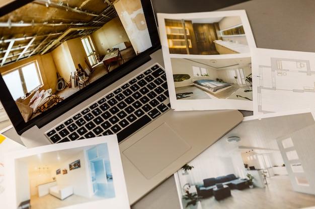 Computadora portátil sobre papel de dibujo arquitectónico