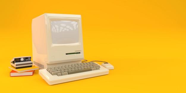 Computadora vieja con libros