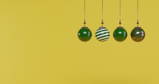Concepto de año nuevo conjunto de bolas de navidad verde oscuro y dorado sobre fondo amarillo.