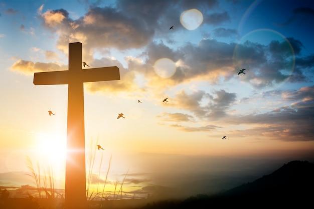 Concepto conceptual silueta cruz negro religión símbolo
