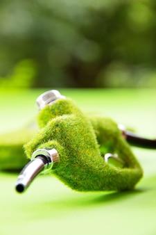 Concepto de energía, boquilla de combustible verde