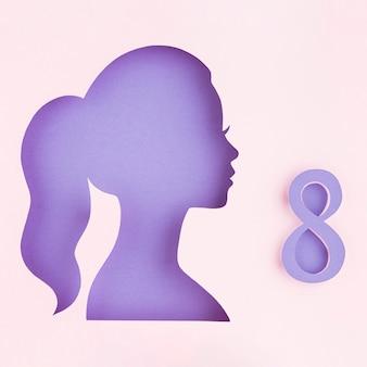 Concepto de día de la mujer de figura de papel femenino lateral