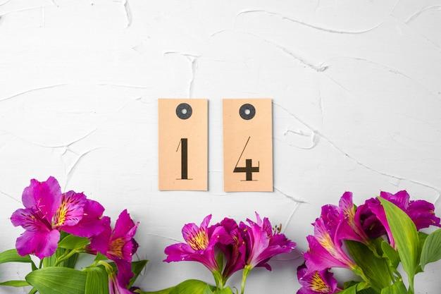 Concepto del día de san valentín. flores frescas con número de 14