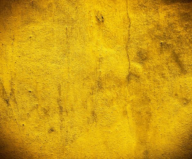 Concepto de la estructura construida de los texturizados de la pared de cemento del oro