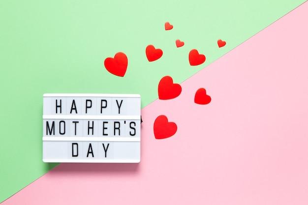 Concepto festivo. tablero de luces con inscripción feliz día de la madre