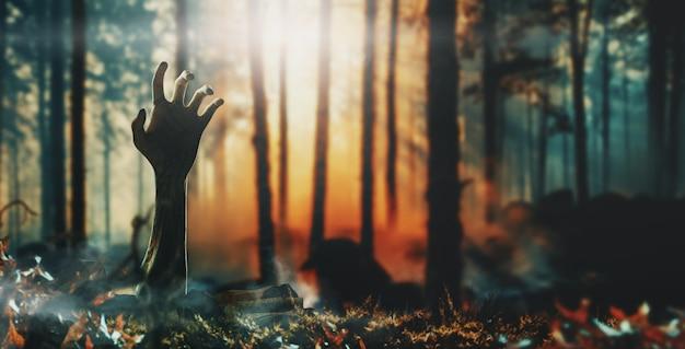 Concepto de halloween, mano de zombie levantándose del suelo. representación 3d