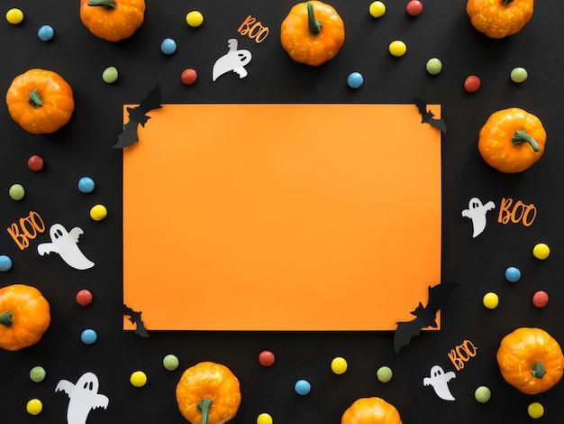 Concepto de halloween de vista superior con calabazas