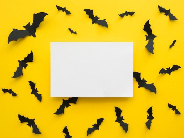 Concepto de halloween de vista superior con murciélagos