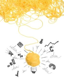 Concepto de idea e innovación con maraña de hilo de lana