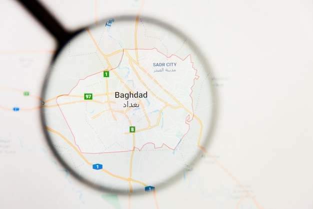 Concepto ilustrativo de visualización de la ciudad de bagdad, iraq en la pantalla a través de una lupa