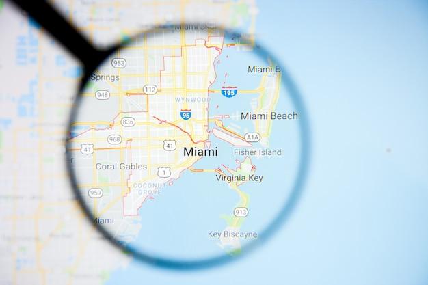 Concepto ilustrativo de visualización de la ciudad de miami en la pantalla a través de una lupa