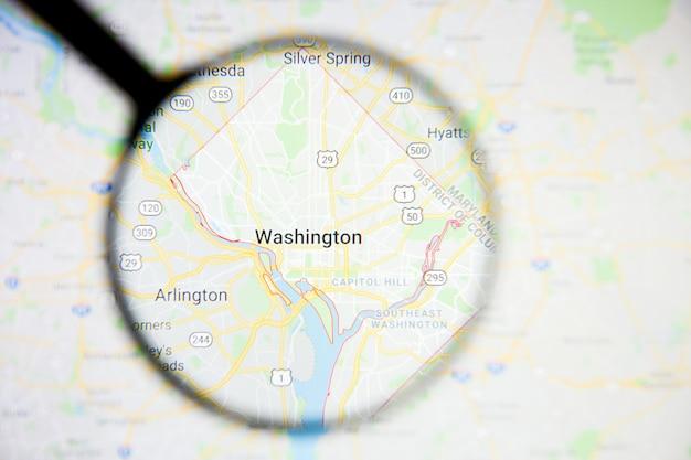 Concepto ilustrativo de visualización de la ciudad de washington en la pantalla a través de una lupa