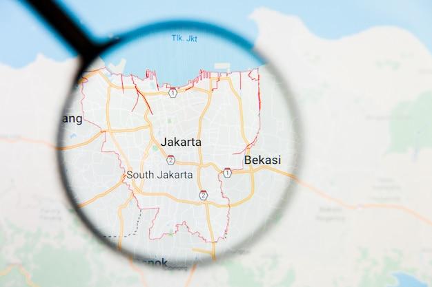 Concepto ilustrativo de visualización de la ciudad de yakarta, indonesia en la pantalla a través de una lupa