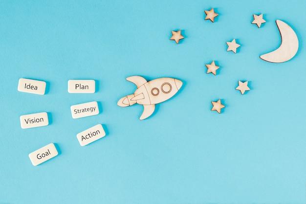 Concepto motivacional, concepto de desarrollo, puesta en marcha. un cohete está volando hacia las estrellas.