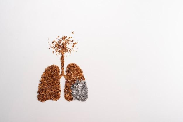 Concepto de no fumar con forma de estocadas de cigarrillos y tabaco