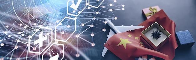 El concepto de la pandemia mundial de coronavirus. la ubicación geográfica del virus. bandera de china y modelo de virus y caja de regalo.