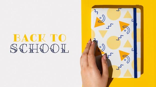Concepto de regreso a la escuela con cuaderno