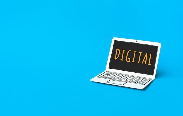Conceptos de marketing digital empresarial con texto en una computadora portátil de maqueta de papel