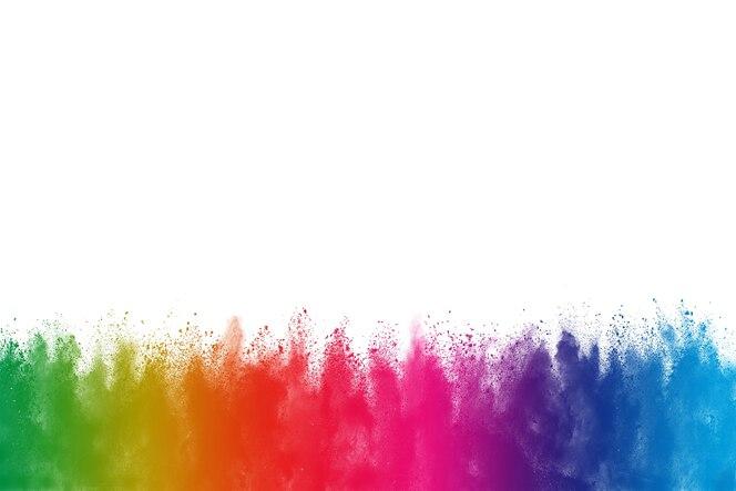 Congelar el movimiento de las explosiones de polvo de colores aislados sobre fondo blanco.