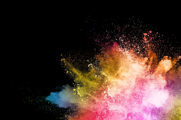 Congelar el movimiento del polvo de color que explota / arroja polvo de color, textura de brillo multicolor.