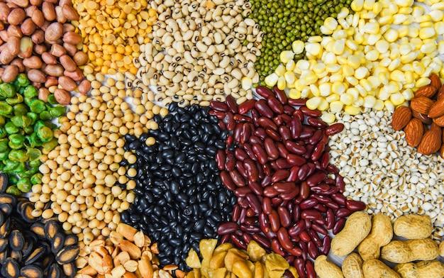 Conjunto de diferentes granos enteros frijoles y semillas de legumbres