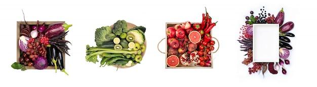 Conjunto de frutas y verduras agrupadas por color (violeta, verde, rojo, naranja) aisladas sobre un fondo blanco