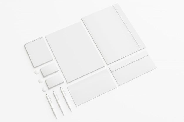 Conjunto de papelería corporativa en blanco.