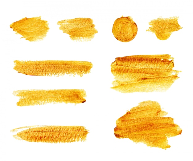 Conjunto de pinceladas de oro brillante dibujado a mano y manchas aisladas