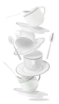 Conjunto de tazas, platos y cucharas que vuelan aisladas sobre fondo blanco