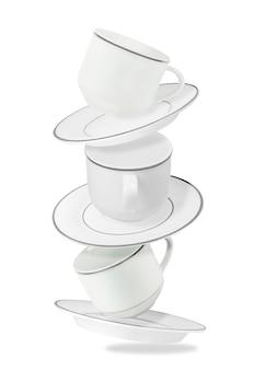 Conjunto de tazas y platos voladores aislados en blanco. caída de utensilios de cocina en blanco