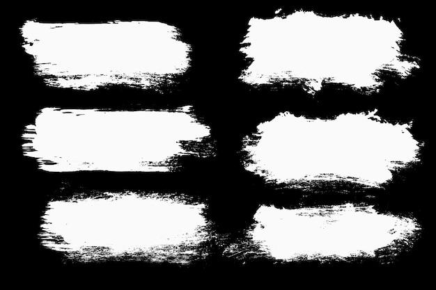 Un conjunto de trazos blancos aislados en un fondo negro. foto de alta calidad