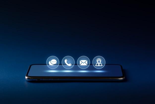 Contáctenos icono de negocios en el teclado de la computadora con el globo