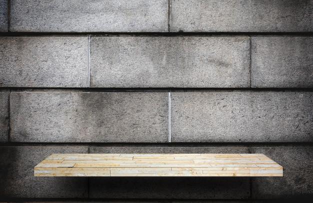 Contador de estantería de piedra amarilla en ladrillo gris para exhibición de productos
