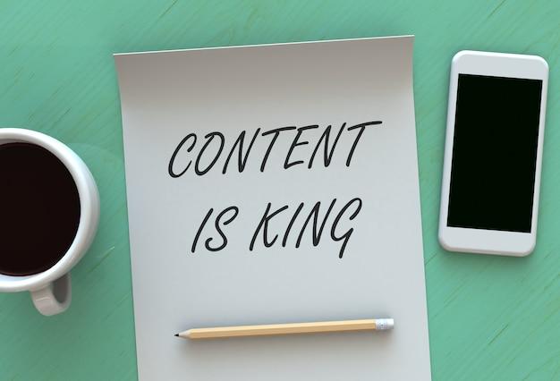 El contenido es el rey, mensaje en papel, teléfono inteligente y café en la mesa