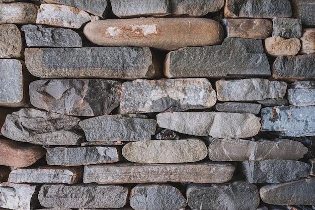 Continua textura detallada de muro de piedra