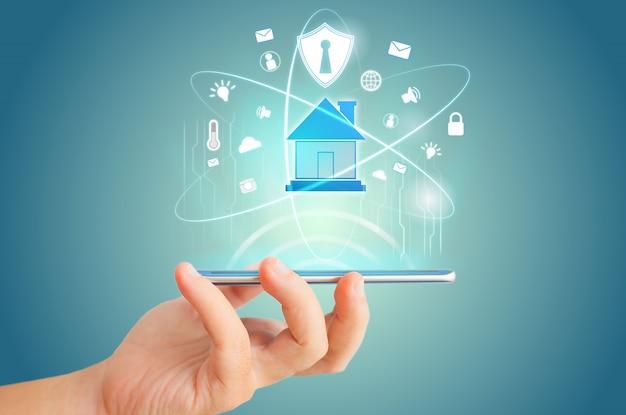 Control remoto del teléfono inteligente para la idea de concepto de tecnología de holograma de casa inteligente.