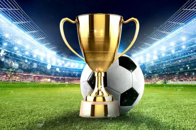 Copa de oro ganador en medio de un estadio de fútbol con audiencia