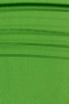 Copie el espacio pintado de verde muro de hormigón